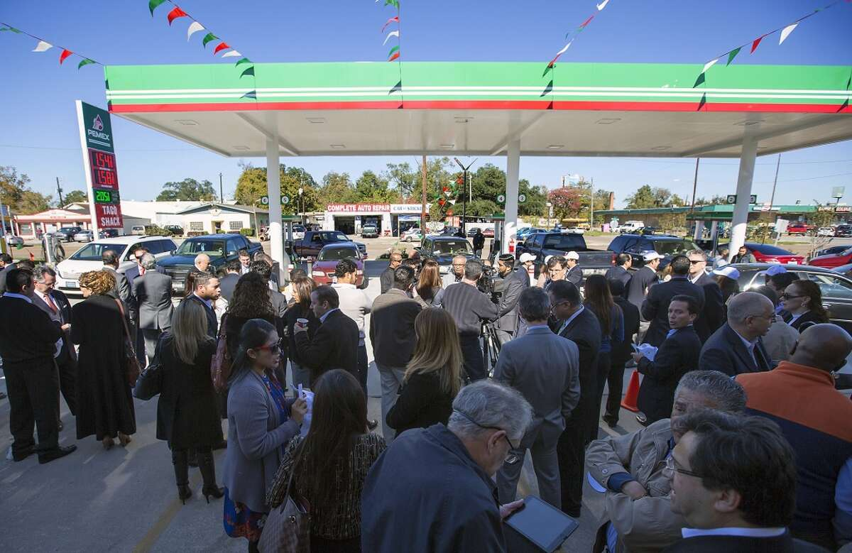 Guests attend the grand opening of PEMEX in the 7900 block of Park Place Blvd, Thursday, Dec. 3, 2015, in Houston. The national energy company of Mexico, Pemex, is launching its brand in the U.S. with retail gasoline stations, starting in Houston. (Cody Duty / Houston Chronicle)