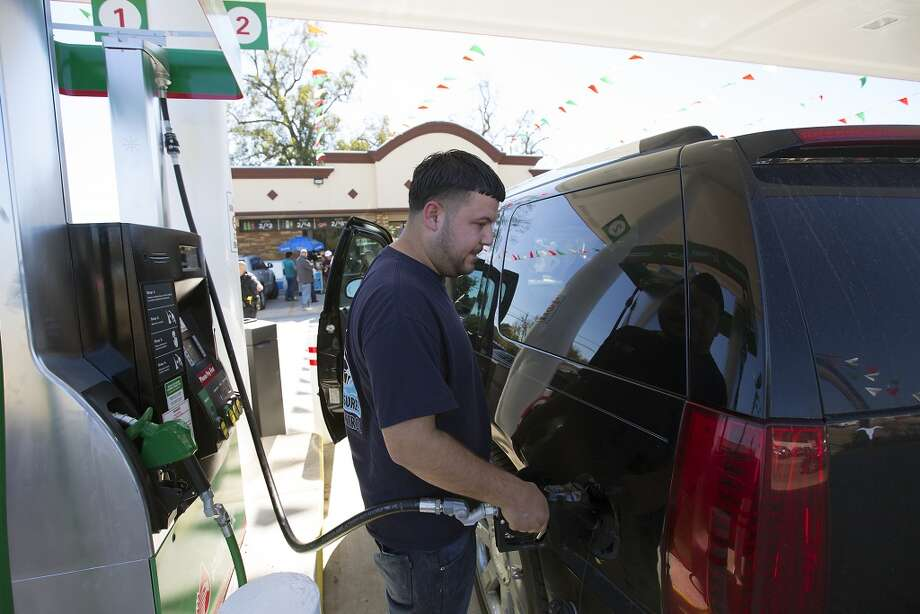 Jose Charles fills up with gas during the grand opening of PEMEX in the 7900 block of Park Place Blvd, Thursday, Dec. 3, 2015, in Houston. (Cody Duty / Houston Chronicle file photo) Photo: Houston Chronicle