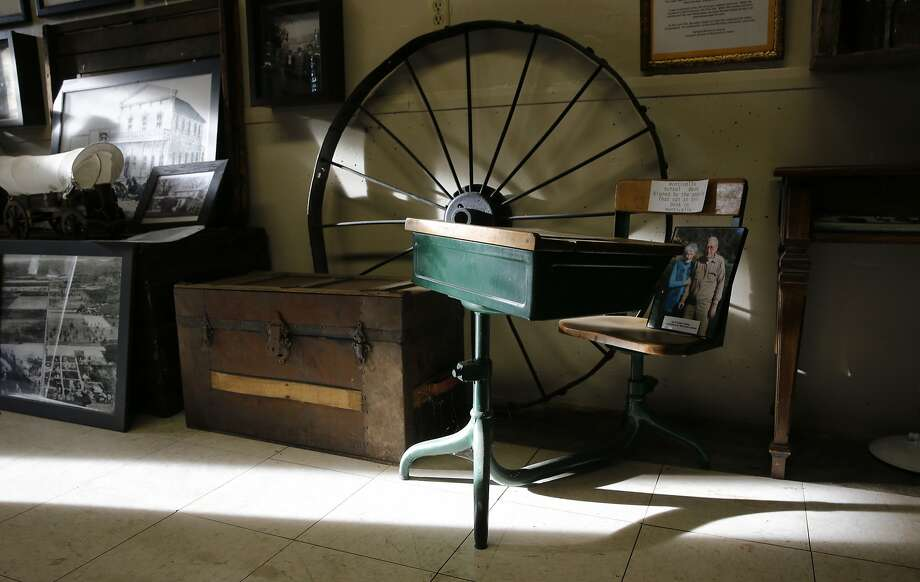 A school desk from the Monticello School was saved before the valley was flooded and is on display at the Berryessa Valley Exhibit at Spanish Flat in Lake Berryessa, Calif., as seen on Tuesday December 1, 2015. The town of Monticello, Ca. is just one of at least 30 Gold Rush-era towns that emerged into ghostly view by the dropping levels of reservoirs around the state from the California drought. Photo: Michael Macor, The Chronicle