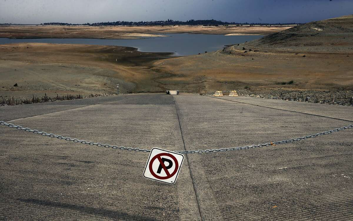 The boat ramp at Hobie Point is hundreds of yards away from the water with levels dropping drastically at Folsom Lake, as seen on Thurs. December 3, 2015, in Folsom, Calif.