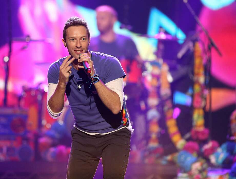 Chris Martin of Coldplay performs at the American Music Awards at the Microsoft Theater, in Los Angeles. Coldplay will perform at the Pepsi Super Bowl 50 Halftime Show on CBS Sunday, Feb. 7, 2016, the NFL announced on Thursday, Dec. 3, 2015. (Photo by Matt Sayles/Invision/AP, File) Photo: Matt Sayles, Associated Press