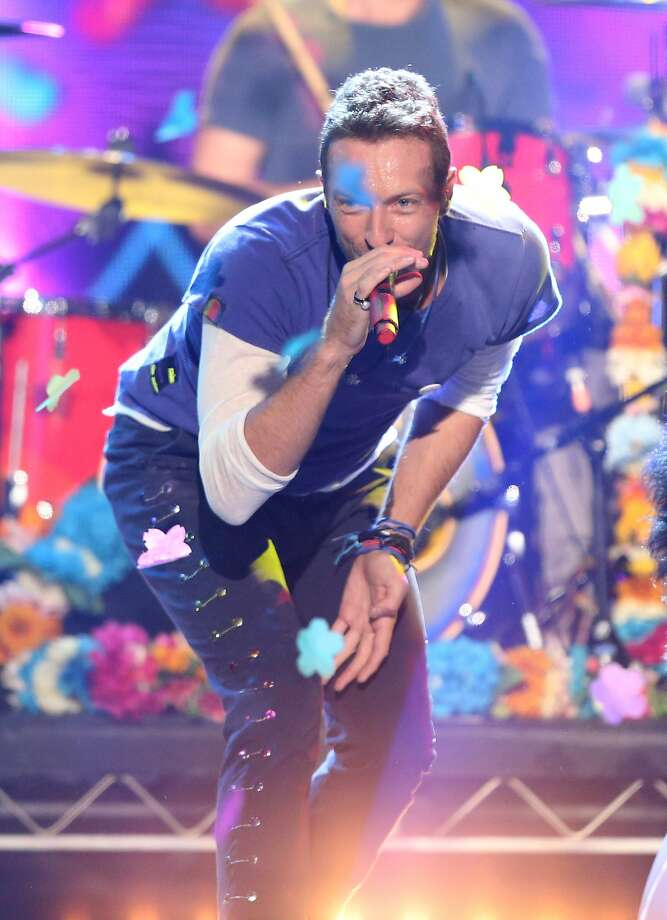 Chris Martin of Coldplay performs at the American Music Awards at the Microsoft Theater on Sunday, Nov. 22, 2015, in Los Angeles.  Photo: Matt Sayles, Associated Press