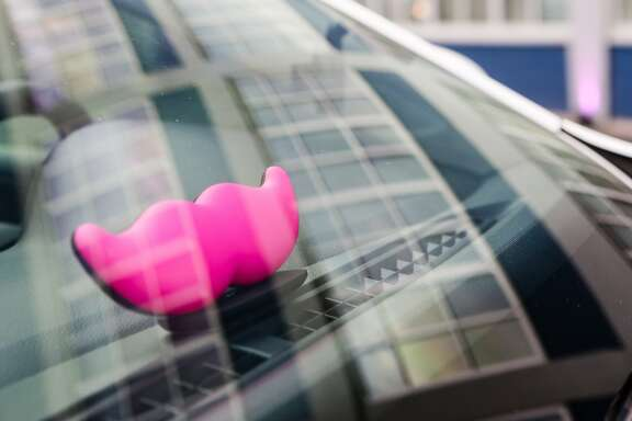 "The new Lyft mustache is displayed in a car at the community driver rally event at LyftÕs headquarters in San Francisco to celebrate the roll out of LyftÕs new look Ð ÒThe Glowstache"" on Monday, January 26, 2015."