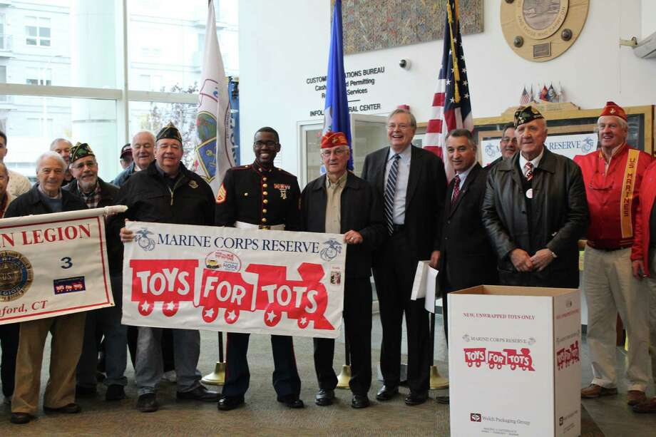 Mayor David Martin, state Sen. Carlo Leone and Toys for Tots Campaign Coordinator George Ducanic were on hand Tuesday to kick off Toys for Tots Month. Photo: Contributed / Contributed / Stamford Advocate Contributed