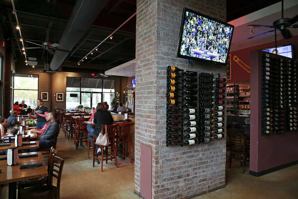 Max's Wine Dive is no stuffy wine bar and instead offers an atmosphere similar to an upscale sports bar.