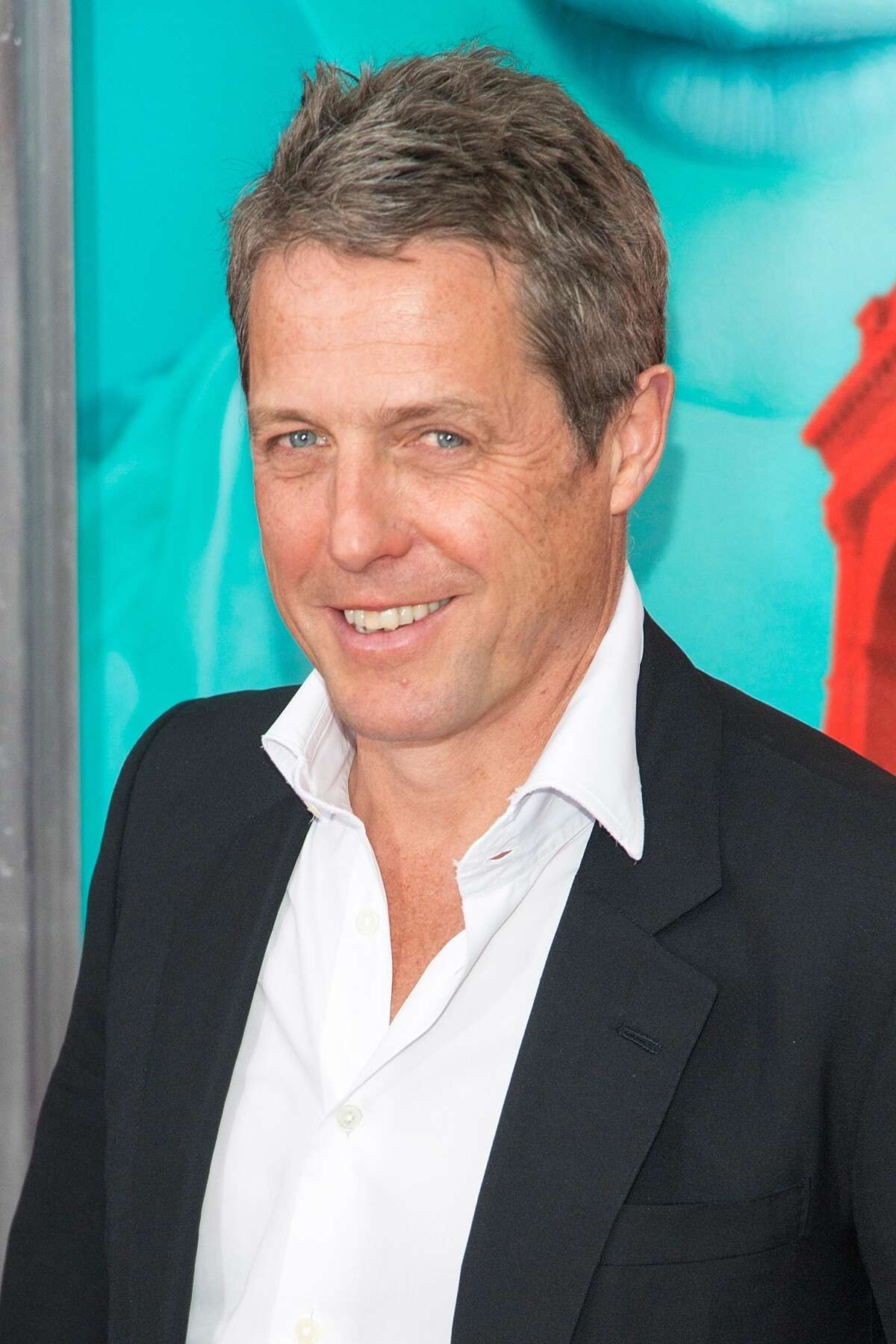 Hugh Grant, pictured in 2015, played the Prime Minister who also loves dancing and lip syncing around 10 Downing Street.