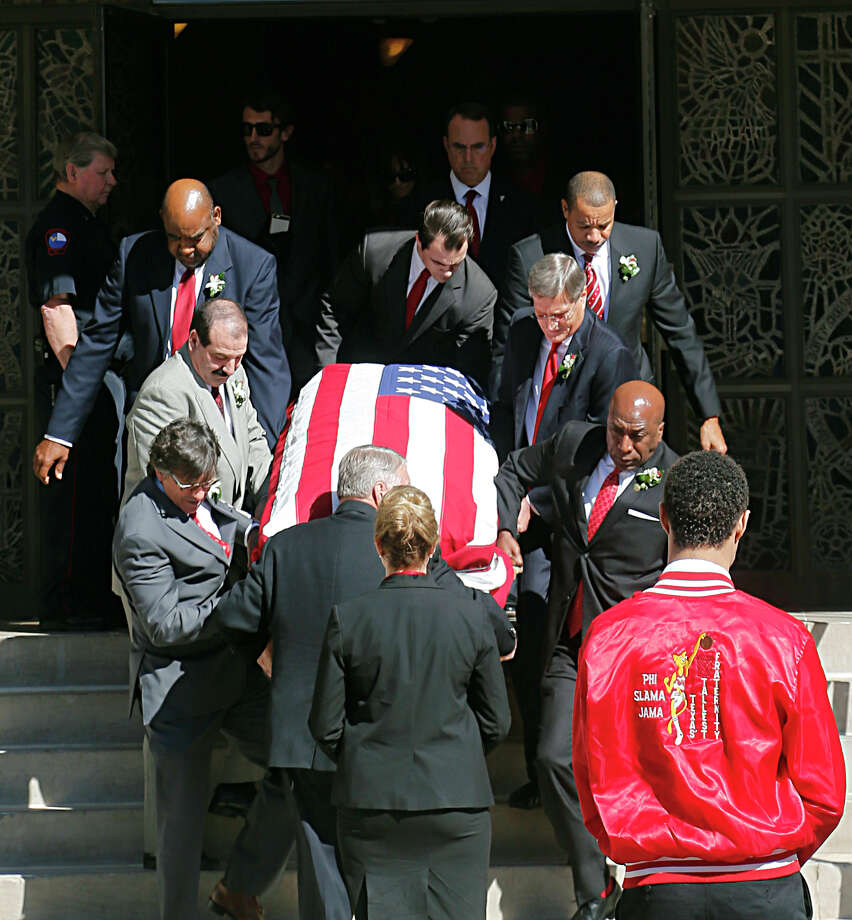 Former University of Houston basketball players carry the casket after funeral services for former University of Houston Head Basketball Coach Guy V. Lewis at First Methodist Church Thursday, Dec. 3, 2015, in Houston. Photo: James Nielsen, Houston Chronicle / © 2015  Houston Chronicle