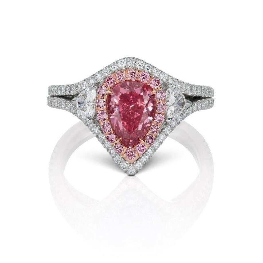lifestyle engagement red pink for is americus saturated rings worth vivid selling style argyle million at of rare pear diamond article diamonds and this shaped trends going
