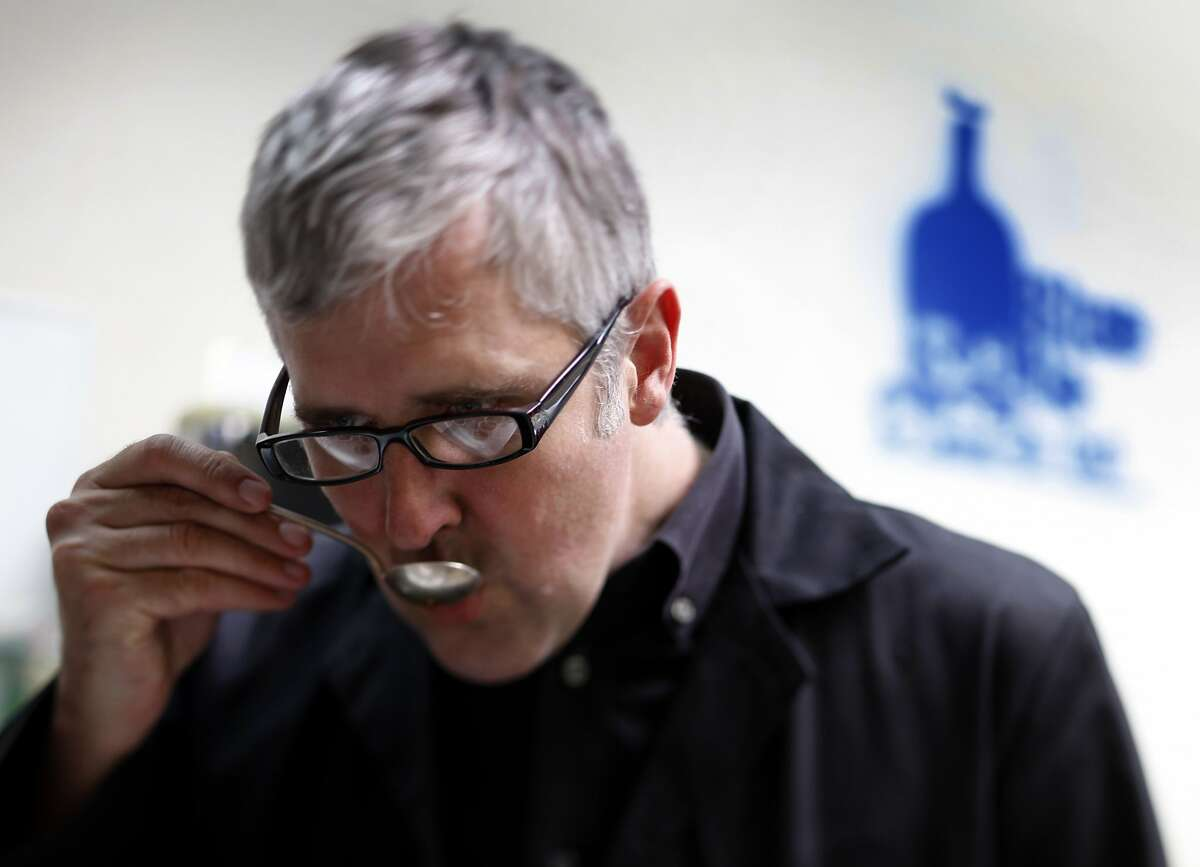 James Freeman tastes samples of coffee beans at his Blue Bottle Coffee Co. roasting plant in Emeryville, Calif., on Tuesday, June 30, 2009.