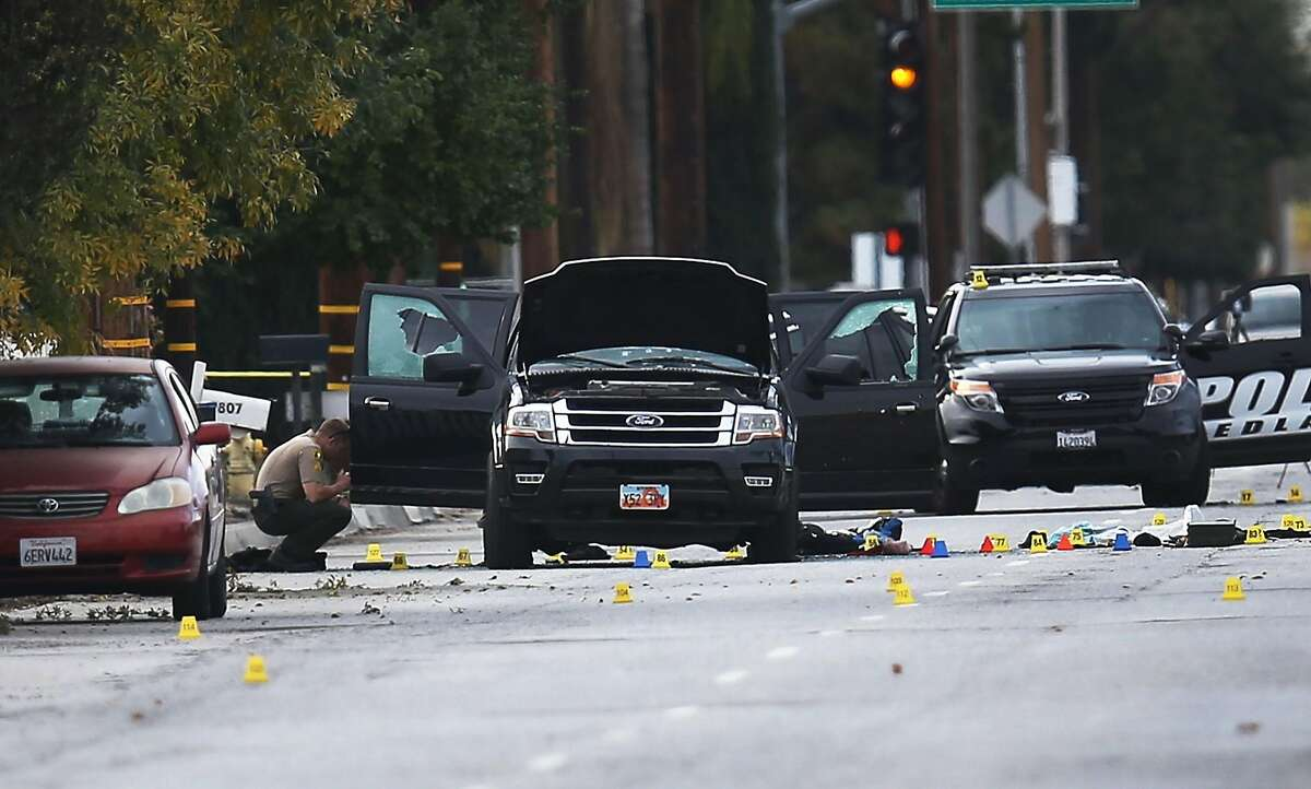 SAN BERNARDINO, CA - DECEMBER 03: Law enforcement officials invesigate around the Ford SUV vehicle that was the scene where suspects of the shooting at the Inland Regional Center were killed on December 3, 2015 in San Bernardino, California. Police continue to investigate a mass shooting at the Inland Regional Center in San Bernardino that left at least 14 people dead and another 17 injured on December 2nd. (Photo by Joe Raedle/Getty Images)