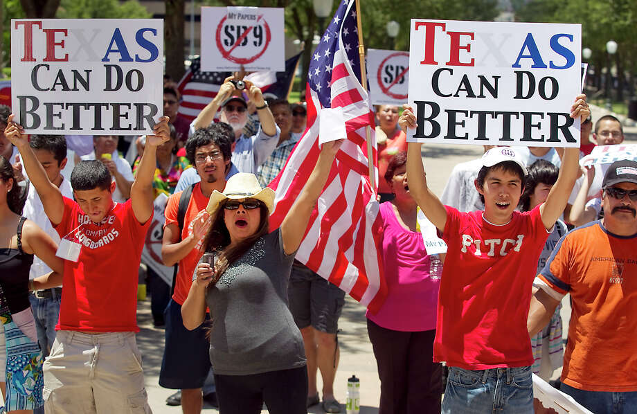 A large crowd gathers in the heat of the day on the south steps of the state Capitol to protest the Sanctuary Cities bill revived in the legislative special session and to rally against immigration bill proposals like SB9, in Austin, Texas, Wednesday, June 15, 2011. (AP Photo/Austin American Statesman, Ralph Barrera) MAGS OUT; NO SALES; TV OUT; INTERNET OUT; AP MEMBERS ONLY Photo: Ralph Barrera, MBR / AP / Austin American-Statesman