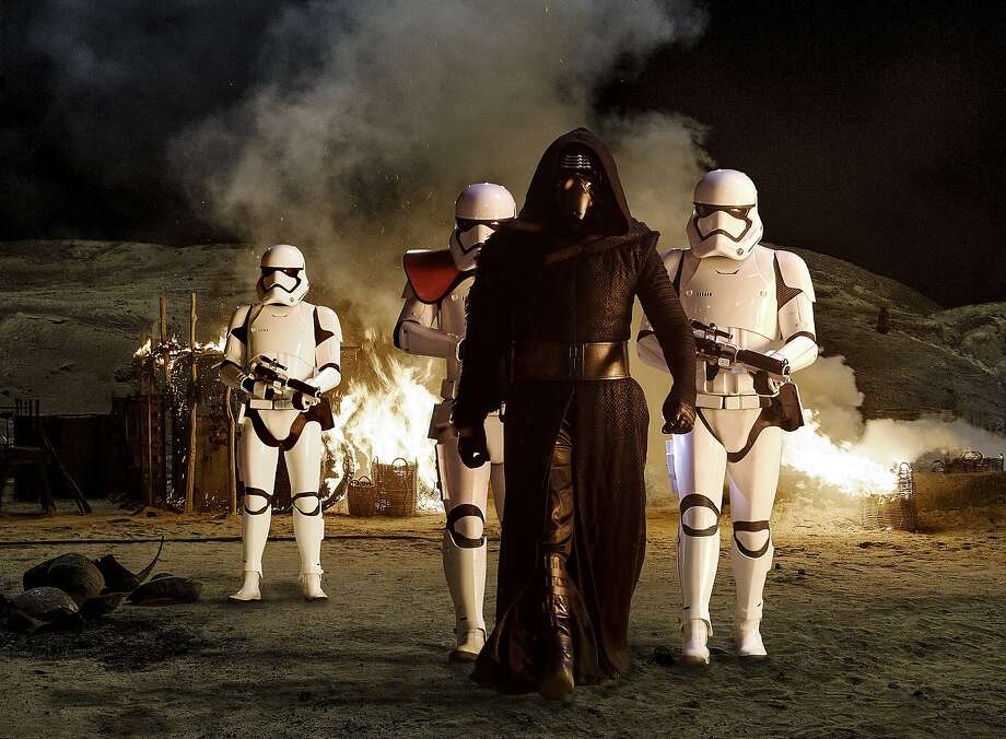 Kylo Ren (Adam Driver) with Stormtroopers From the new Disney/Lucasfilm production ÒStar Wars: The Force Awakens. Photo: David James, Lucasfilm