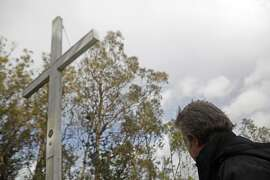 Larry Hicok of the  of East Bay Atheists Society, looks up at the source of contention, the cross  which is located Albany Hill Park, in Albany Calif. on December 3, 2015. It has foundation issues  and cracks at the base and is maintained by the Lions Club. There is also a electoral wire that is connected from the structure to a tree, which Hicok points out is  illegal.