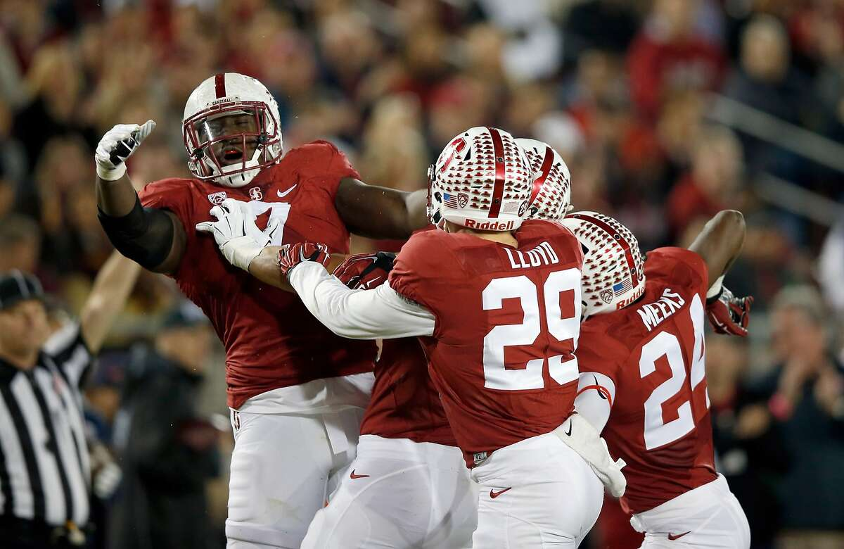 PALO ALTO, CA - NOVEMBER 21: Aziz Shittu #7 of the Stanford Cardinal is congratulated by teammates after he made a tackle against the California Golden Bears at Stanford Stadium on November 21, 2015 in Palo Alto, California. (Photo by Ezra Shaw/Getty Images)