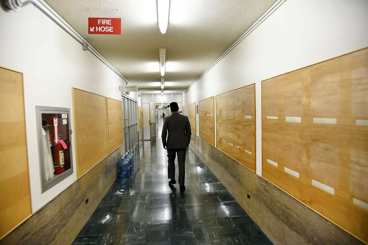 Alex Bastian, spokesman for District Attorney George Gasc-n, walks past the now bare walls of the former SF Police offices on the 6th floor of the Hall of Justice in San Francisco, CA Thursday, December 3, 2015.