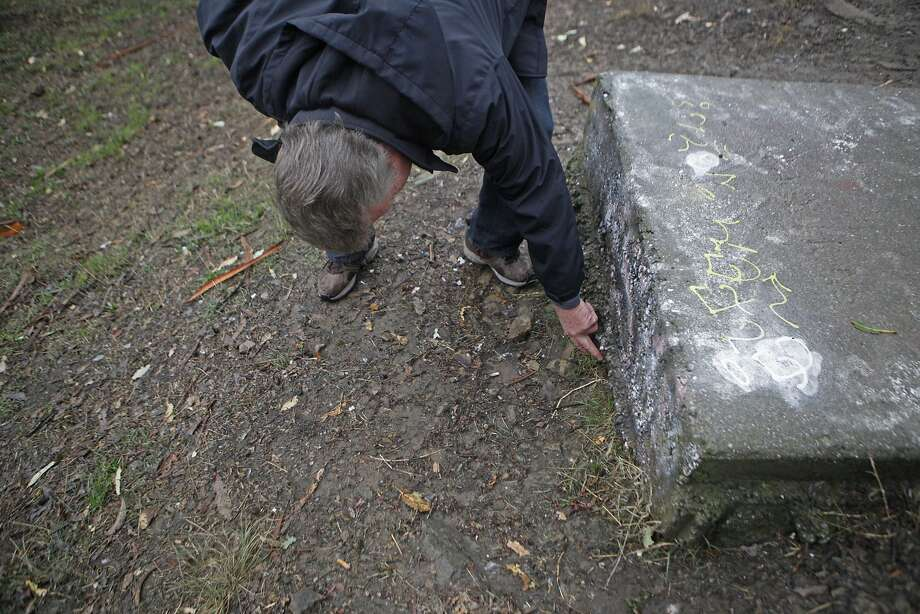 Larry Hicok, of East Bay Atheists Society, pointing out foundation issues  on the base of the cross, which is maintained by the Lions Club. The cross is located at Albany Hill Park, in Albany Calif. on December 3, 2015. Photo: Franchon Smith, The Chronicle
