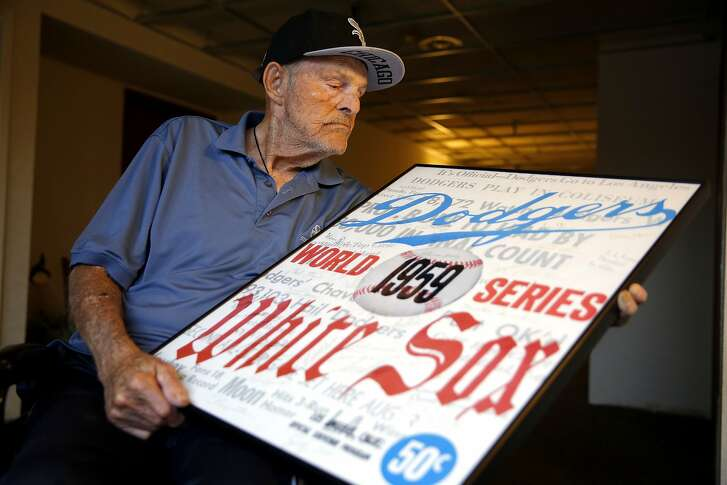 Jim Landis looks at a poster signed by players from both teams that played in the 1959 World Series at Brookdale Assisted Living in Napa, California, on Thursday, Dec. 3, 2015.