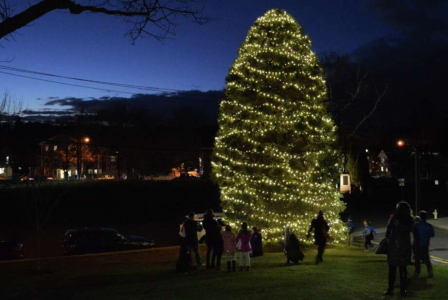 The Christmas tree at Town Hall glows against a dusky December sky shortly after the annual & O Christmas tree! Lighting fete brightens holiday spirits ... azcodes.com
