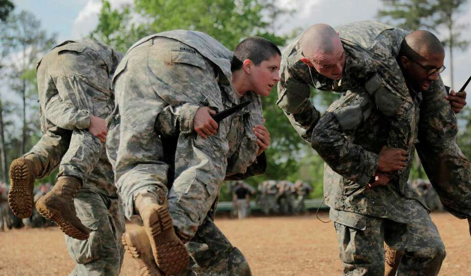 In a handout photo provided by the U.S. Army, Capt. Kristen Griest, center, participates in combatives training during the Ranger Course at Ft. Benning, Ga., April 20, 2015. Capt. Griest is one of the first two women to graduate from the course. Defense Secretary Ashton Carter on Dec. 3, 2015, announced that the Pentagon will open all combat roles in the military to women. The Pentagon put out a mandate in January 2013 to integrate women into all combat jobs by 2016 or justify exemptions. (Spc. Nikayla Shodeen/U.S. Army via The New York Times) --EDITORIAL USE ONLY Photo: SPC. NIKAYLA SHODEEN, HO /  US ARMY