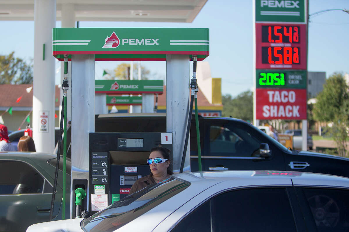 Motorists fill up during the grand opening of the first Pemex station in the U.S., in the 7900 block of Park Place Boulevard. The company plans more stations in the Houston area.
