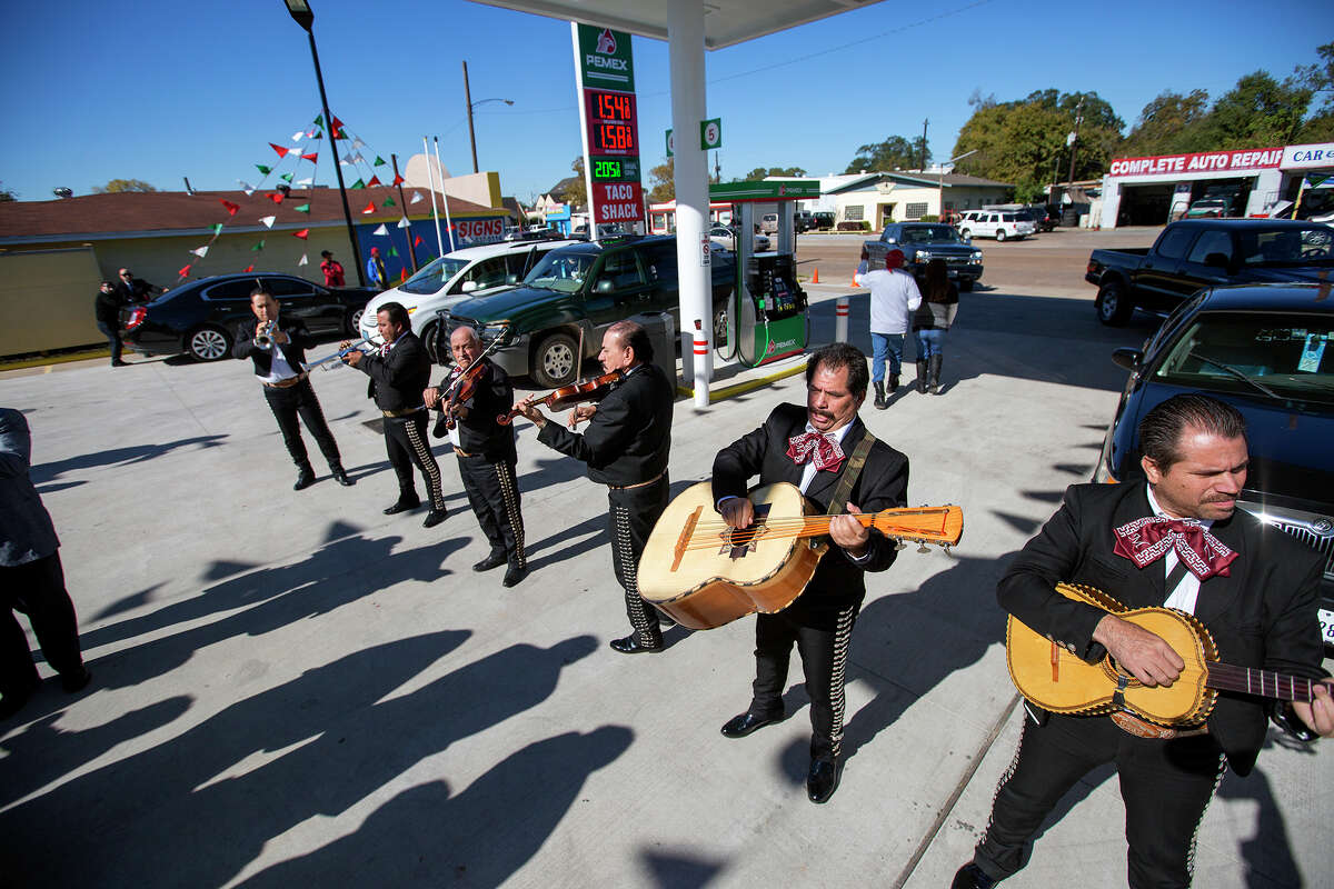 Mariachis entertain guests during the grand opening Thursday of a Pemex station on Park Place Boulevard near Hobby Airport. The energy company of Mexico, Pemex is launching its brand in the U.S. with retail gas stations, beginning in Houston.