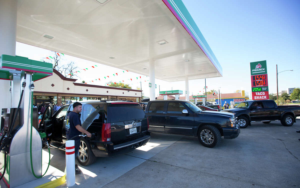 Jose Charles fills up during the opening of a Pemex station in Houston last month. There was an outcry in Mexico about how much cheaper Pemex's prices were in Houston.