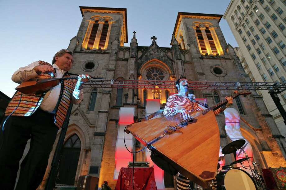 Members of the Flying Balalaika Brothers Sergey Vashchenko (left) and Aaryn Russell perform with the band during Carnival Cuatro celebrating Geekdom's fourth birthday Thursday in Main Plaza. Geekdom now has about 780 members. Photo: Edward A. Ornelas /San Antonio Express-News / © 2015 San Antonio Express-News