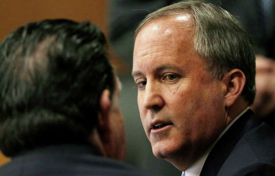 Texas Attorney General Ken Paxton, right, talks with one of his attorney during a pre-trial motion hearing at the Collin County Courthouse on Tuesday, Dec. 1, 2015, in McKinney, Texas. Paxton is accused of encouraging wealthy investors to pump more than $100,000 into a tech startup called Servergy without revealing he was being paid by the company. (Jae S. Lee/The Dallas Morning News Via AP, Pool) Photo: Jae S. Lee, POOL / POOL The Dallas Morning News