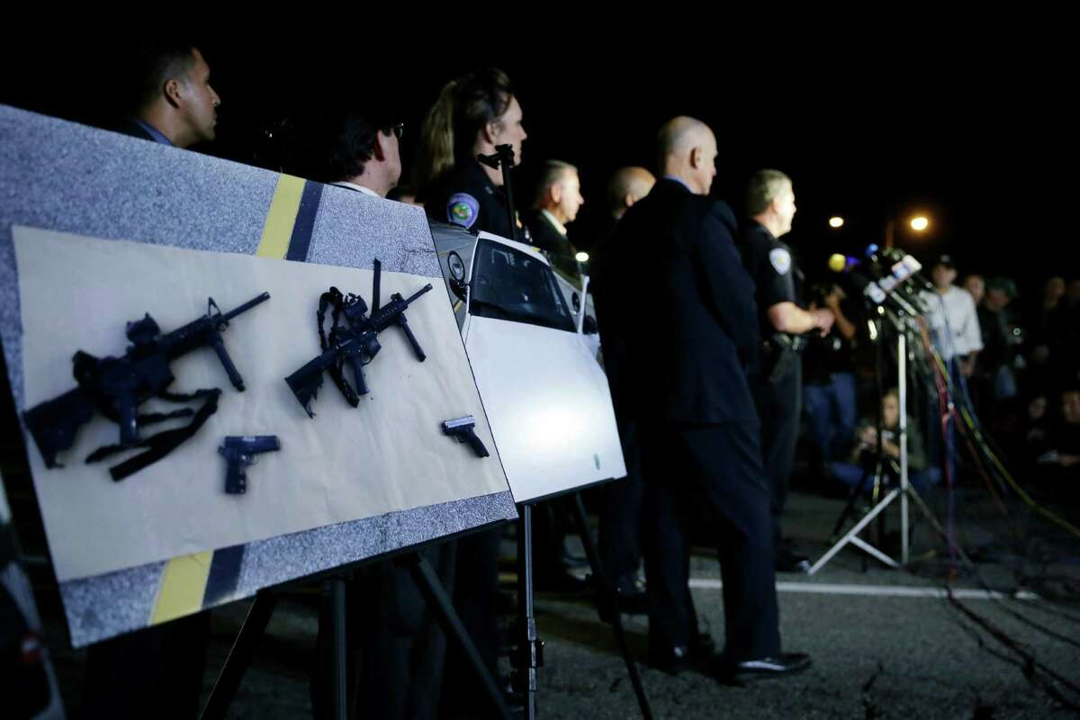 Police crime photos are displayed during a press conference near the site of yesterday's mass shooting on Thursday, Dec. 3, 2015 in San Bernardino, Calif.