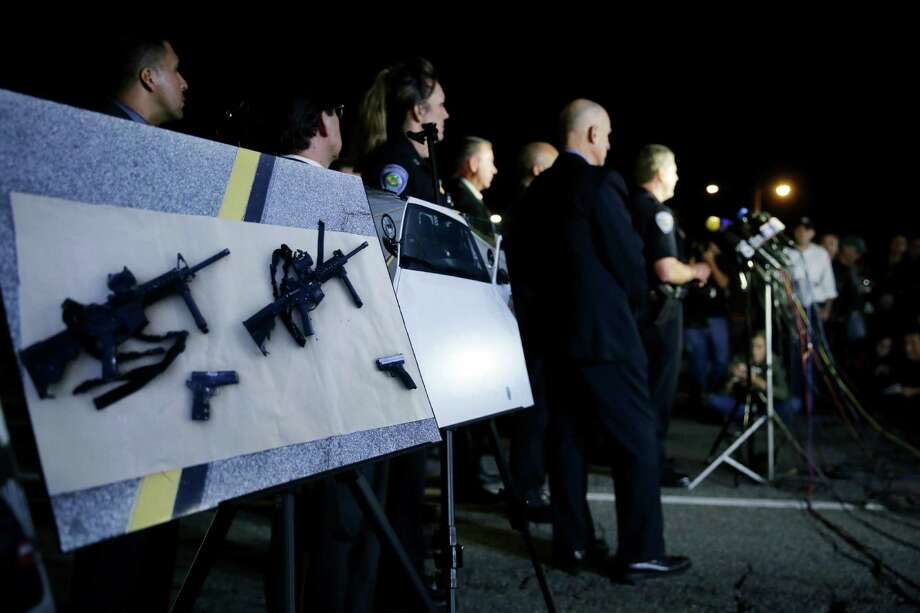 Police crime photos are displayed during a press conference near the site of yesterday's mass shooting on Thursday, Dec. 3, 2015 in San Bernardino, Calif. Photo: Chris Carlson, Associated Press / AP