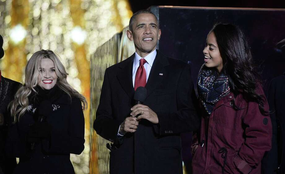 WASHINGTON, DC - DECEMBER 02: Actress Reese Witherspoon, President Barack Obama and Malia Obama perform on stage during the national Christmas tree lighting ceremony on the Ellipse south of the White House December 3, 2015 in Washington, DC. The lighting of the tree is an annual tradition attended by the president and the first family. (Photo by Olivier Douliery- Pool/Getty Images) ORG XMIT: 594821687 Photo: Olivier Douliery / 2015 Getty Images