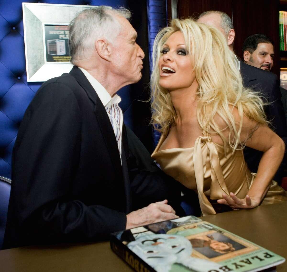 Playboy founder Hugh Hefner and model Pamela Anderson attend the Hugh Hefner Autographs Limited Edition Six-Volume Anthology Party by Taschen on December 10, 2009 in Los Angeles.
