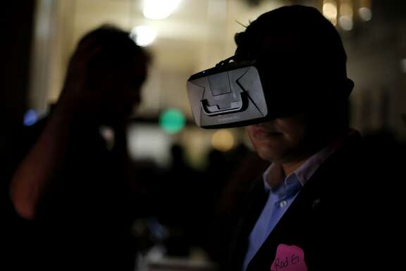 Rod Gaerlan views an image using an Oculus Rift headset at the virtual reality conference Off Planet VR in Berkeley, California, on Thursday, Dec. 3, 2015.
