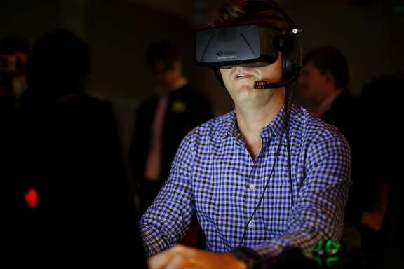 Chris Collins of High Fidelity demos a program using an Oculus Rift headset at the virtual reality conference Off Planet VR in Berkeley, California, on Thursday, Dec. 3, 2015.