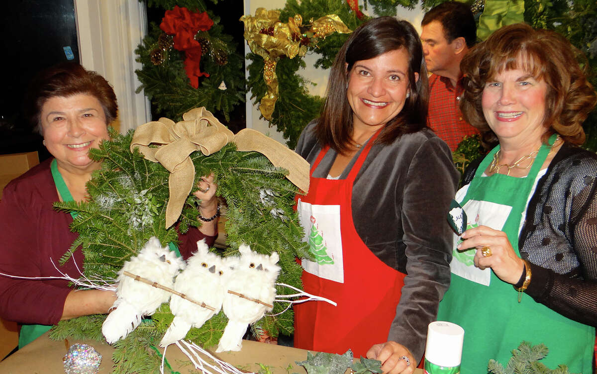"""Santa's elves"" Ginny Latham, Vicki Ihlefeld and Georgeann Hoffman made wreaths at the Fairfield Christmas Tree Festival's opening night."