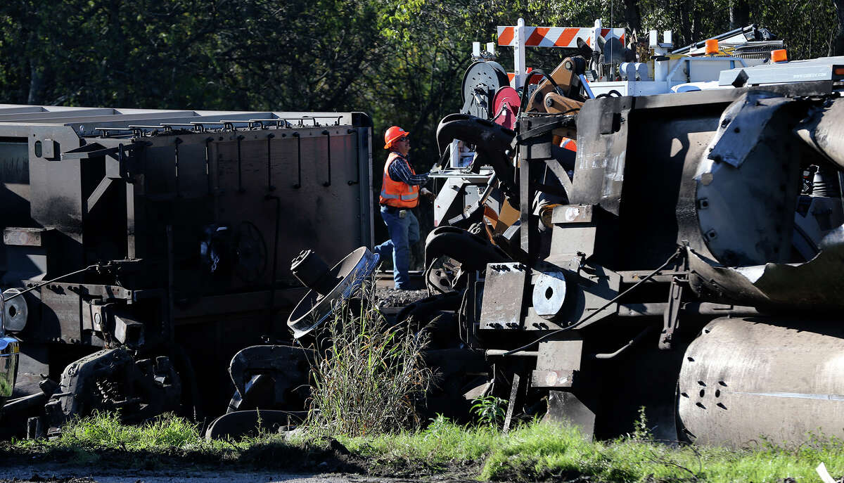 Crews work Friday December 4, 2015 on South Presa street near Hot Wells after a Union Pacific train carrying coal derailed spilling some of its cargo. The accident happened about 12:30 a.m. and no injuries were reported. Traffic on northbound Presa is open, but the southbound lanes will remain closed until more progress is made on the clean up effort.