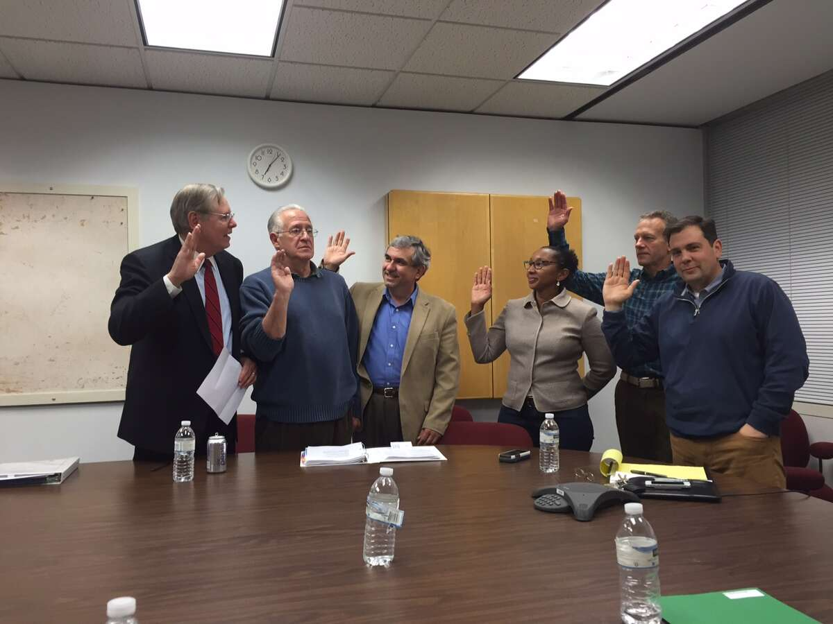 Mayor David Martin administers the oath of office Wednesday to Board of Education members David Mannis, Michael Altamura, Jennienne Burke, Andy George and Gerald Bosak. The five were sworn in before a meeting of the board's superintendent search committee.