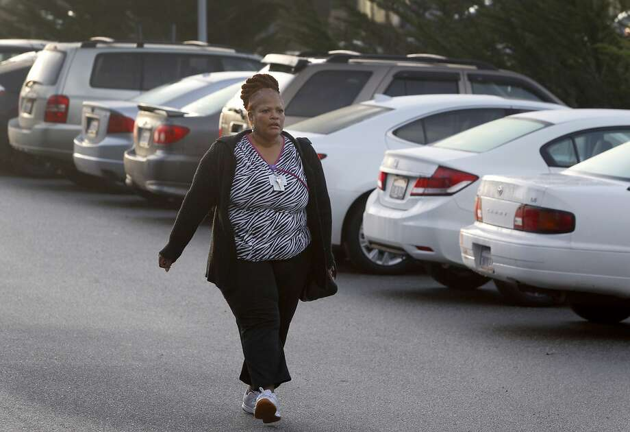 Valoria Russell-Benson returns to her carafter finishing her overnight shift at Laguna Honda Hospital in San Francisco. Russell-Benson commutes to her job in the city from her home in Vacaville, a trip which can take up to two or three hours each way. Photo: Paul Chinn, The Chronicle