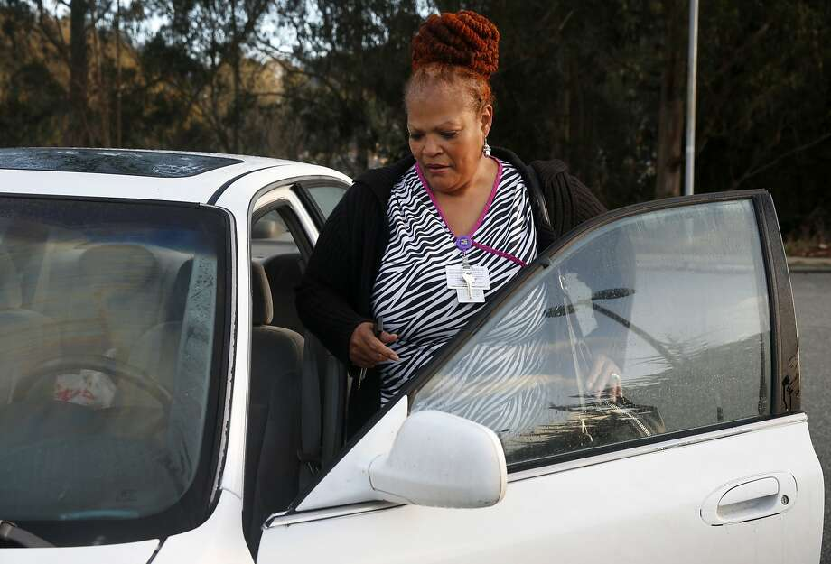 Valoria Russell-Benson gets into her car after finishing her overnight shift at Laguna Honda Hospital in San Francisco. Russell-Benson commutes to her job in the city from her home in Vacaville, a trip which can take up to two or three hours each way. Photo: Paul Chinn, The Chronicle