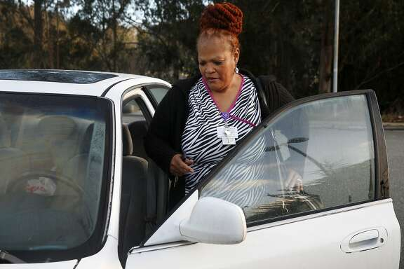 Valoria Russell-Benson gets into her car after finishing her overnight shift as a certified nurse's assistant at Laguna Honda Hospital in San Francisco, Calif. on Friday, Dec. 4, 2015. Russell-Benson commutes to her job in the city from her home in Vacaville, a trip which can take up to two or three hours each way.