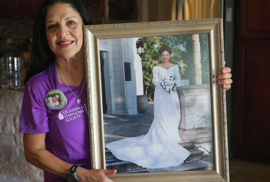 Diane Garcia holds a portrait of her daughter Ivor, who died 15 years ago of leukemia. Garcia runs in the Rock 'n' Roll San Antonio Marathon as part of the Leukemia and Lymphoma Society-Team in Training (TNT). She has raised more than $50,000 to help fight cancer over the years. Photo: John Davenport /San Antonio Express-News / ©San Antonio Express-News/John Davenport