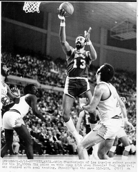 Wilt Chamberlain, above, sacrificed some of his scoring to help the 1971-72 Lakers. He averaged 19.2 rebounds per game. Gail Goodrich, left, led the team at 25.9 points per game. Photo: Upi