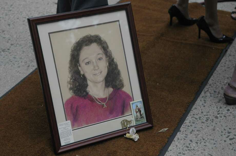 A artists drawing of Arica Lynn Schneider is seen outside the Rensselaer County Courthouse on Tuesday morning, July 12, 2011 in Troy.  Michael Mosley was sentenced to life for the murders of Samuel Holley and Arica Lynn Schneider.  (Paul Buckowski / Times Union) Photo: Paul Buckowski / 00013874A