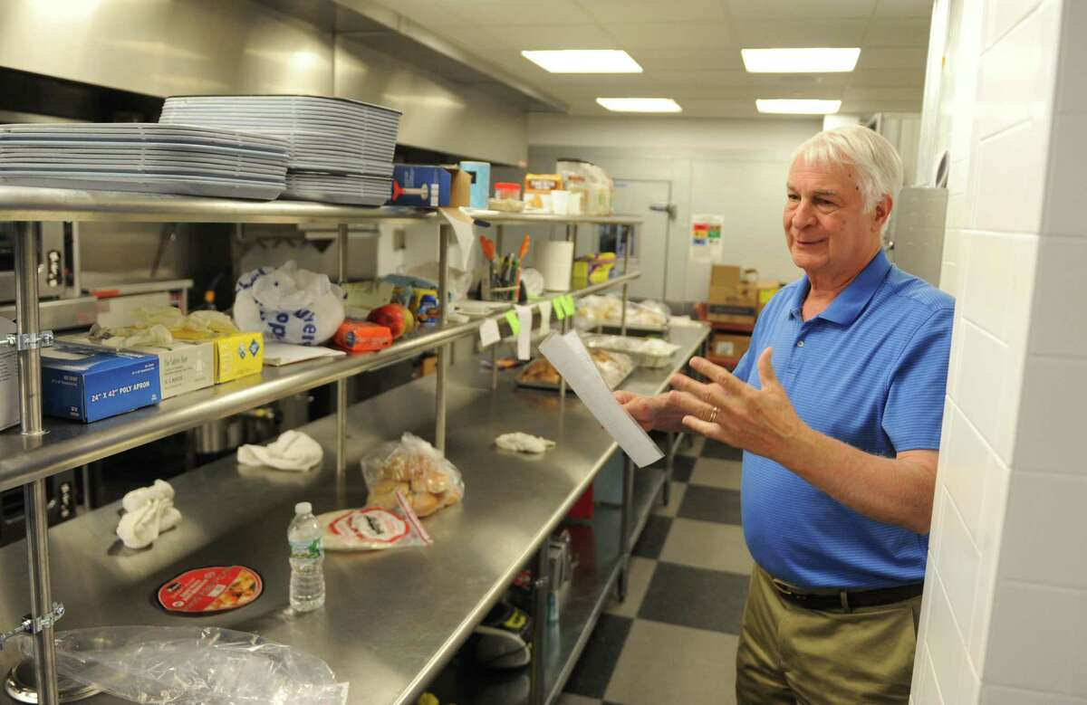 New Covenant Advisory Board Chairman Paul Harinstein shows the soup kitchen at the new New Covenant House of Hospitality in Stamford in July.