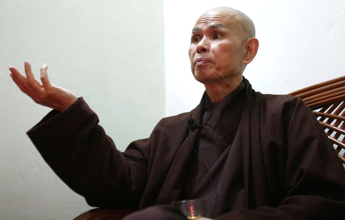 ** ADVANCE FOR THURSDAY, MARCH 29 ** FILE ** Vietnamese monk Thich Nhat Hanh talks during an interview in Hanoi, Vietnam, in this Tuesday, March 29, 2005 file photo. For the second time in two years, Thich Nhat Hanh, a Buddhist monk who was forced to live in exile for nearly four decades, has returned to his home land. Hanh has been drawing large crowds with his calls for national reconciliation. And he has been given more freedom to move and speak than the government would have allowed in the past. (AP Photo/Richard Vogel, File)