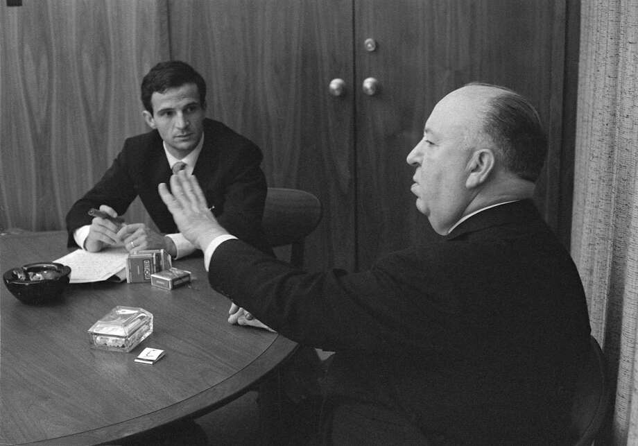 """French filmmaker François Truffaut listens to Alfred Hitchcock in this scene from """"Hitchcock/Truffaut,"""" a film culled from six days of interviews between the two directors. Photo: Philippe Halsman"""