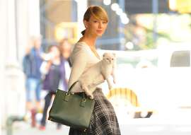 Singer Taylor Swift and Cat are seen in Soho on September 16, 2014 in New York City. (Photo by Raymond Hall/GC Images)