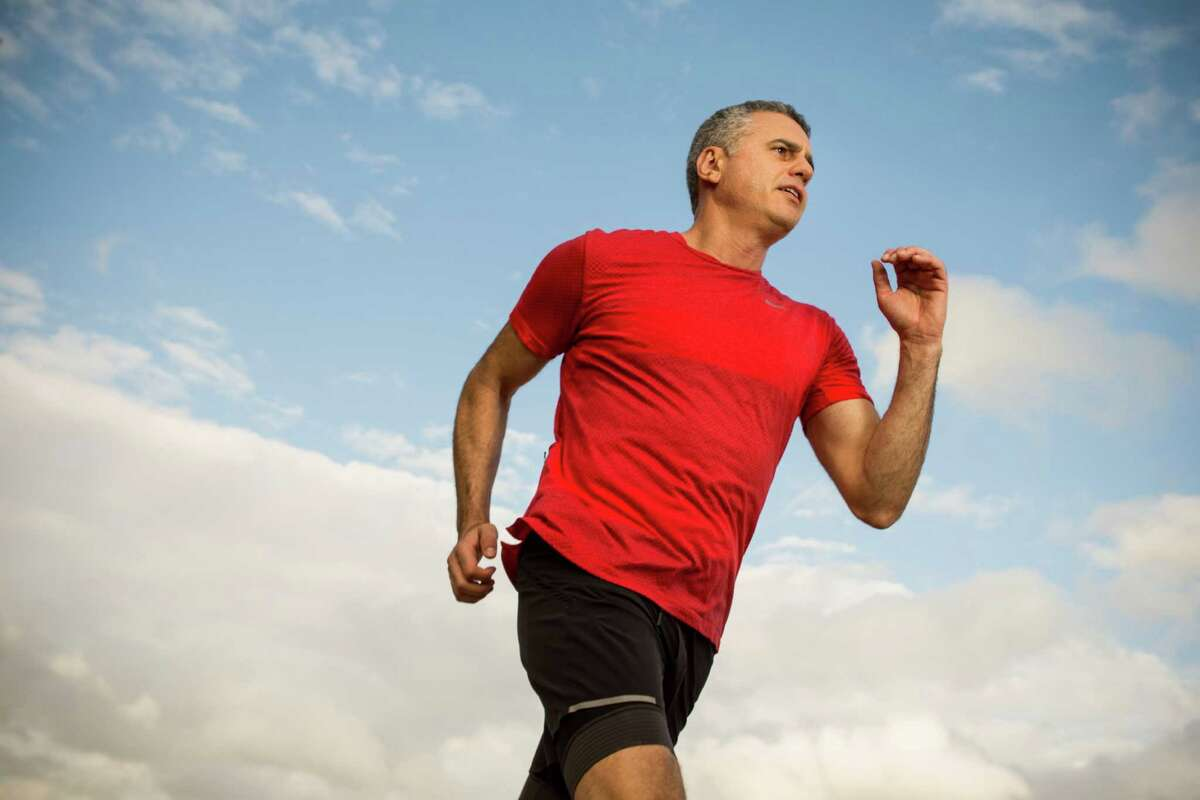 Dr. Garth Davis, a bariatric surgeon at the Davis Clinic, poses for a portrait while running in Memorial Park on Wednesday, Nov. 25, 2015, in Houston. ( Brett Coomer / Houston Chronicle )