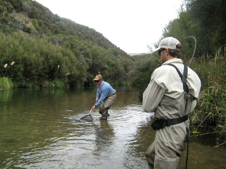 Fishing in the gin-clear, forest-fringed Tauranga-Taupo River on New Zealand's North Island, where rainbow trout reign supreme, is an adventure. Photo: Rolf Potts / ONLINE_YES