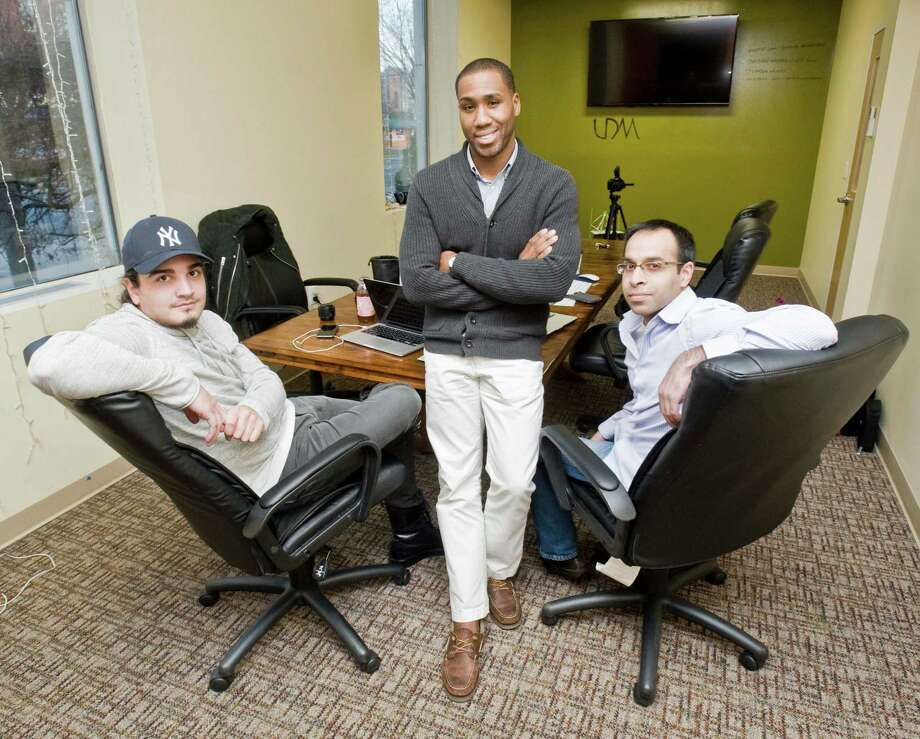 The founders of UpDesign Media, Lenny Ayala, Ardonyx Day and Vivek Carrasco at the Innovation Center on Main Street in Danbury. Thursday, Dec. 3, 2015 Photo: Scott Mullin / For The / The News-Times Freelance